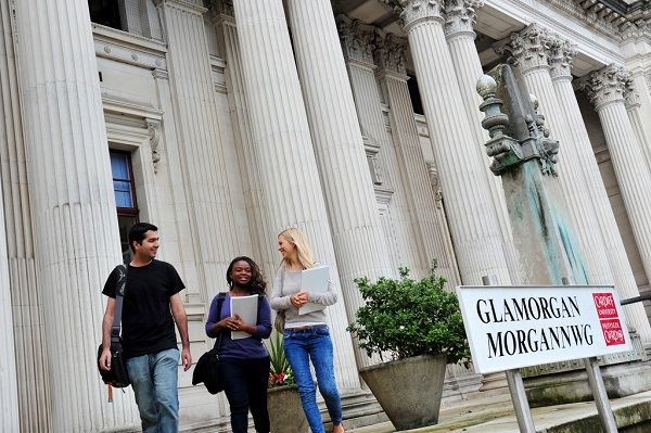 Cardiff University students walking past the Glamorgan Building