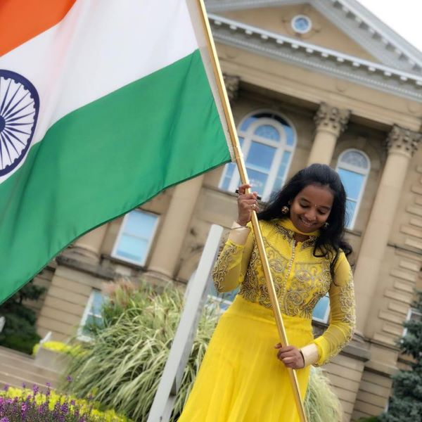 WIU Indian student with flag